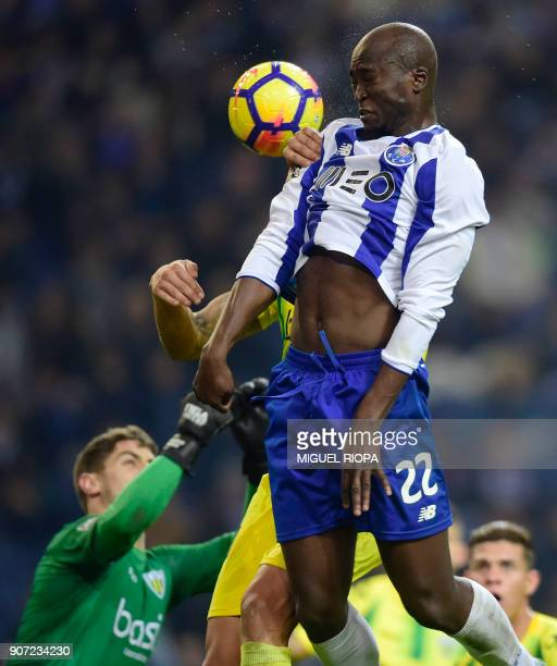 Porto's Portuguese midfielder Danilo Pereira heads the ball during the Portuguese league football match between FC Porto and CD Tondela at the Dragao...