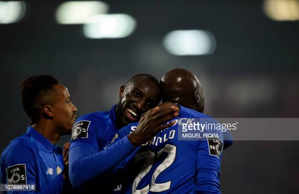 Porto's Portuguese midfielder Danilo Pereira is congratulated by teammate Malian forward Moussa Marega after scoring a goal during the Portuguese...