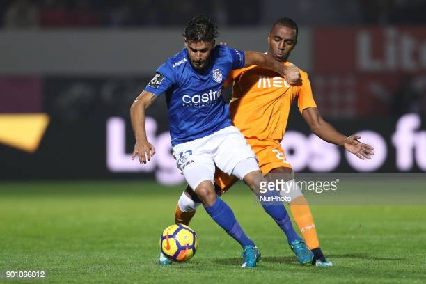 Porto's Portuguese midfielder Danilo Pereira vies with Feirense's Portuguese forward Hugo Seco during the Premier League 2016/17 match between CD...