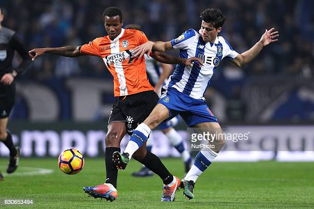 Porto's Portuguese midfielder Joao Carlos Teixeira vies with Feirense's forward Peter Etebo during the League Cup 2016/17 match between FC Porto and...