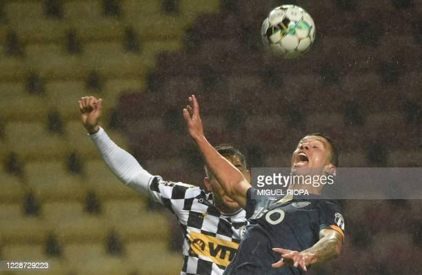 Porto's Portuguese midfielder Romario Baro jumps for the ball during the Portuguese league football match Boavista FC against FC Porto at the Estadio...