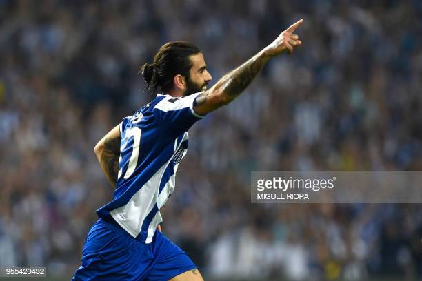 Porto's Portuguese midfielder Sergio Oliveira celebrates after scoring a goal during the Portuguese league football match between FC Porto and CD...