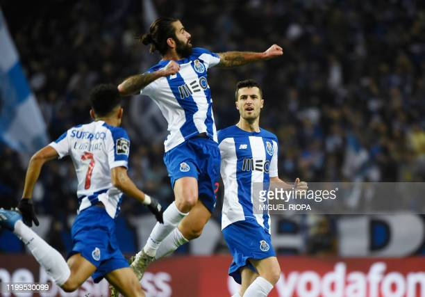Porto's Portuguese midfielder Sergio Oliveira celebrates with teammate Spanish defender Ivan Marcano after scoring a goal during the Portuguese...