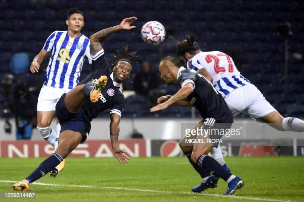 Porto's Portuguese midfielder Sergio Oliveira heads the ball to score a goal during the UEFA Champions League group C football match between FC Porto...