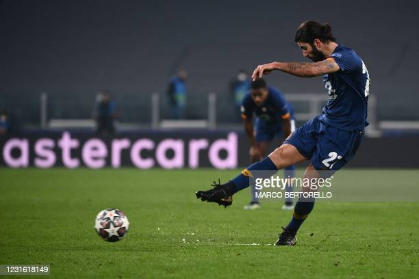 Porto's Portuguese midfielder Sergio Oliveira shoots a free kick to score his second goal during the UEFA Champions League round of 16 second leg...