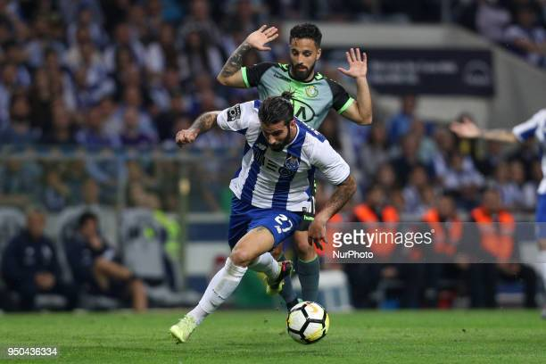 Porto's Portuguese midfielder Sergio Oliveira vies with Vitoria Setubal's Portuguese midfielder Joao Costinha during the Premier League 2016/17 match...