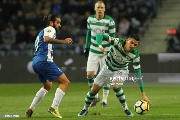 Porto's Portuguese midfielder Sergio Oliveira with Sporting's Argentinian midfielder Rodrigo Battaglia during the Portuguese Cup 2017/18 match...