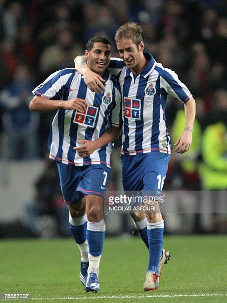 FC Porto's Ricardo Quaresma celebrates with Raul Meireles after he scored the second goal of the match against Besiktas during their Group A...