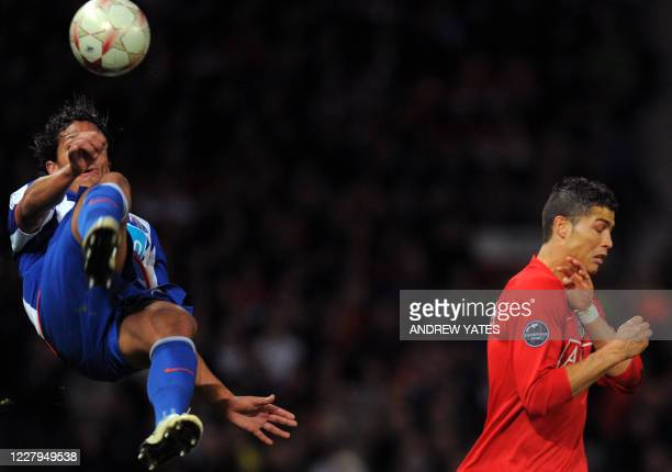 Porto's Romanian defender Cristian Sapunaru competes with Manchester United's Portugese midfielder Cristiano Ronaldo during their UEFA Champions...