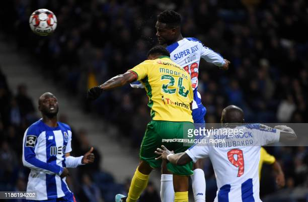 Porto's Senegalese midfielder Mamadou Loum Ndiaye heads the ball to score a goal during the Portuguese league football match between FC Porto and FC...