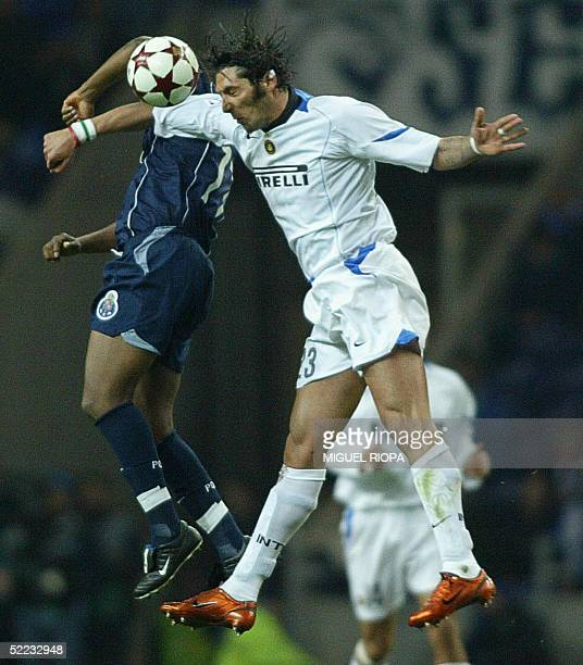 Porto's South African Benny McCarthy jumps for the ball with Inter's Marco Materazzi during the European Champions League first knockout round first...