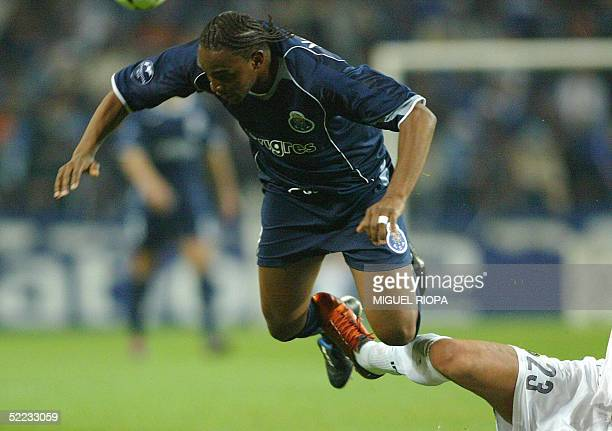 Porto's South African forward Benny McCarthy is tackled by Inter's Marco Materazzi during the European Champions League first knockout round first...