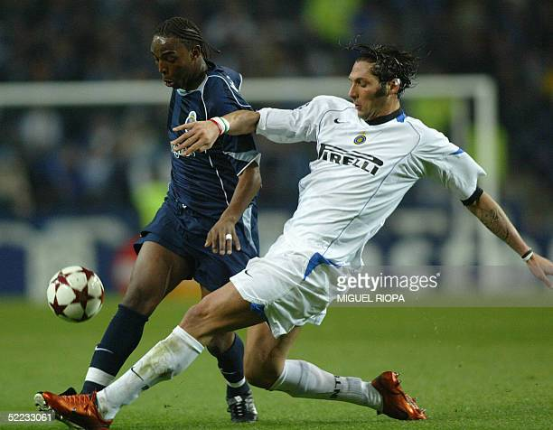 Porto's South African forward Benny McCarthy vies with Inter's Materazzi during their European Champions League first knockout round first leg match...