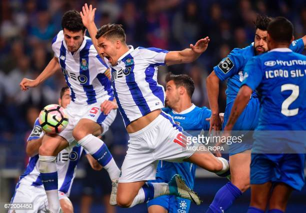 Porto's Spanish defender Ivan Marcano and teammate forward Andre Silva try to score during the Portuguese league football match FC Porto vs CD...