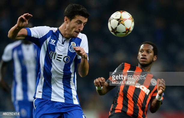 Porto's Spanish defender Ivan Marcano heads the ball next to Shakhtar Donetsk's Brazilian midfielder Fred during the UEFA Champions League Group H...