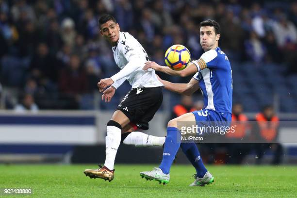 Porto's Spanish defender Ivan Marcano in action with Hurtado of Vitoria SC during the Premier League 2017/18 match between FC Porto and Vitoria SC at...