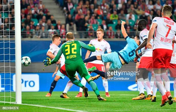 Porto's Spanish defender Ivan Marcano scores the 32 goal past Leipzig's Hungarian goalkeeper Peter Gulacsi during the UEFA Champions League group G...