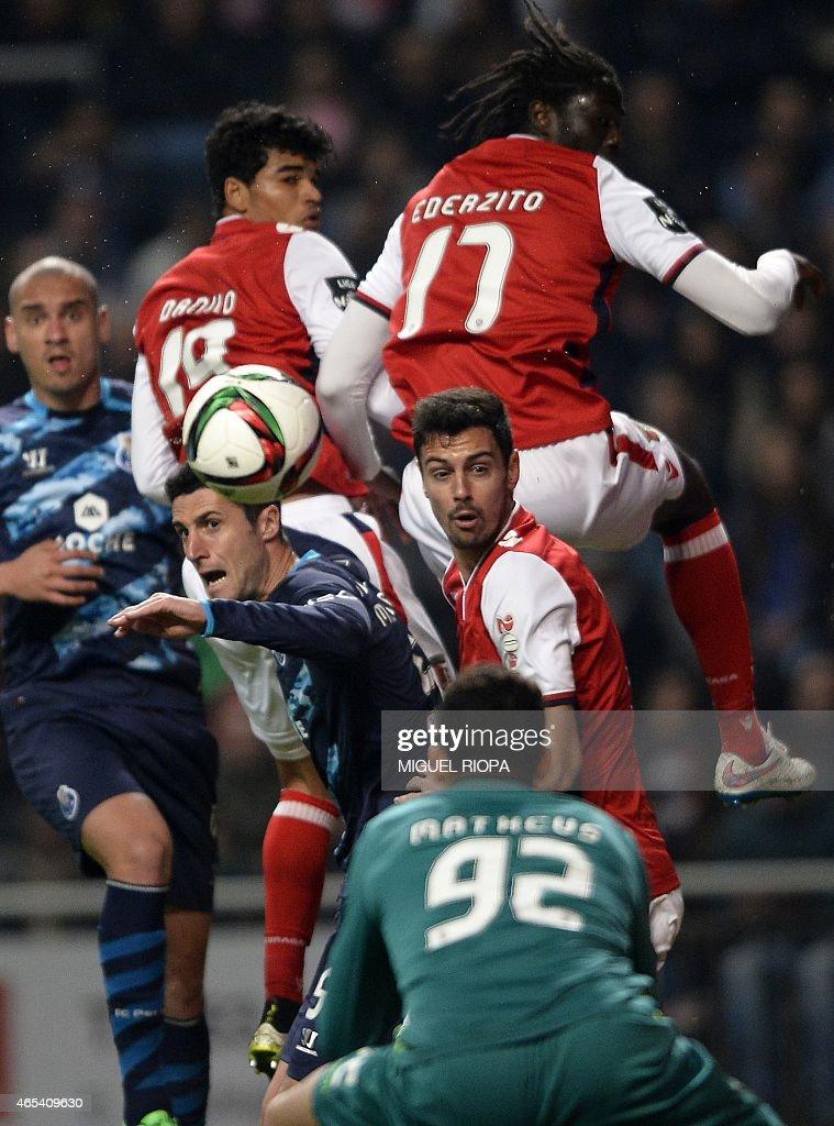 Porto's Spanish defender Ivan Marcano (CentreL) vies with Braga's defender Andre Pinto (CentreR) during the Portuguese league football match SC Braga vs FC Porto at the Municipal stadium in Braga on March 6, 2015. Porto won the match 1-0.