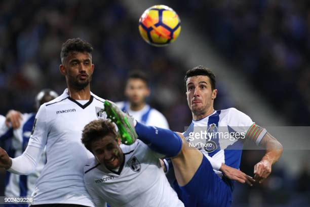 Porto's Spanish defender Ivan Marcano vies with g during the Premier League 2017/18 match between FC Porto and Vitoria SC at Dragao Stadium in Porto...