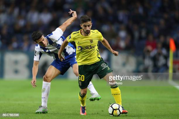 Porto's Spanish defender Ivan Marcano with Pacos Ferreira's Portuguese midfielder Antonio Xavier during the Premier League 2017/18 match between FC...