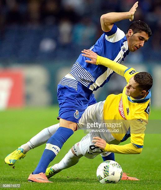 Porto's Spanish defender Jose Angel vies with Arouca's forward Jose Branco Zequinha during the Portuguese League football match FC Porto vs FC Arouca...