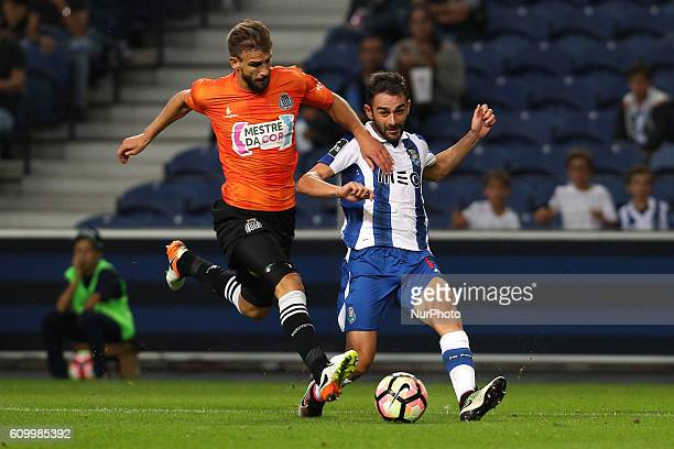 Porto's Spanish forward Adrian Lopez in action with Boavista's Portuguese defender Nuno Henrique during the Premier League 2016/17 match between FC...