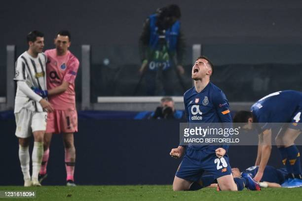 Porto's Spanish forward Toni Martinez celebrates as FC Porto's Argentinian goalkeeper Agustin Marchesin comforts Juventus' Spanish forward Alvaro...