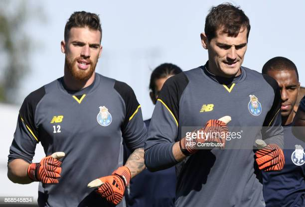Porto's Spanish goalkeeper Iker Casillas and his teammate goalkeeper Jose Sa run during a training session at the Olival Training Centre in Vila Nova...