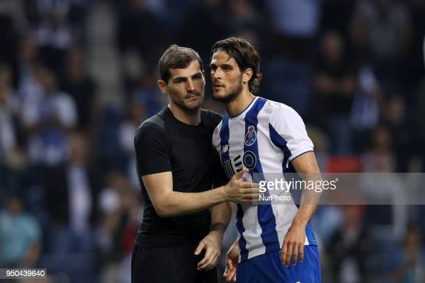 Porto's Spanish goalkeeper Iker Casillas and Porto's Portuguese forward Goncalo Paciencia celebrates the victory in the match during the Premier...