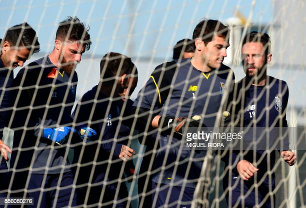 Porto's Spanish goalkeeper Iker Casillas and Portuguese goalkeeper Jose Sa jog with teammates during a training session at the Olival Training Centre...
