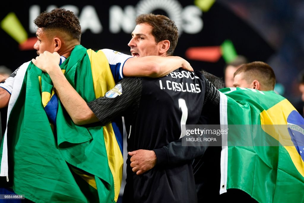 Porto's Spanish goalkeeper Iker Casillas (C) celebrates with teammates after winning the league title following the Portuguese league football match between FC Porto and CD Feirense at the Dragao stadium in Porto on May 6, 2018.