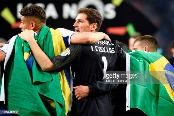 Porto's Spanish goalkeeper Iker Casillas celebrates with teammates after winning the league title following the Portuguese league football match...