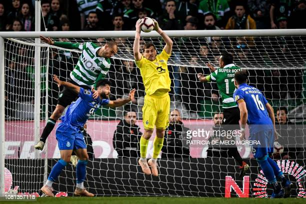 TOPSHOT Porto's Spanish goalkeeper Iker Casillas grabs the ball during the Portuguese League football match between Sporting CP and FC Porto at the...