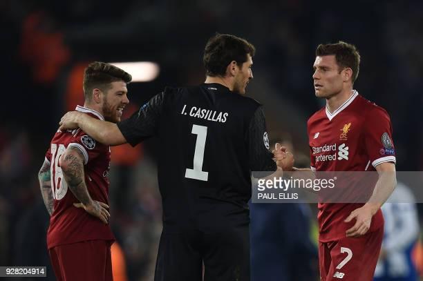 Porto's Spanish goalkeeper Iker Casillas greets Liverpool's Spanish defender Alberto Moreno and Liverpool's English midfielder James Milner after the...
