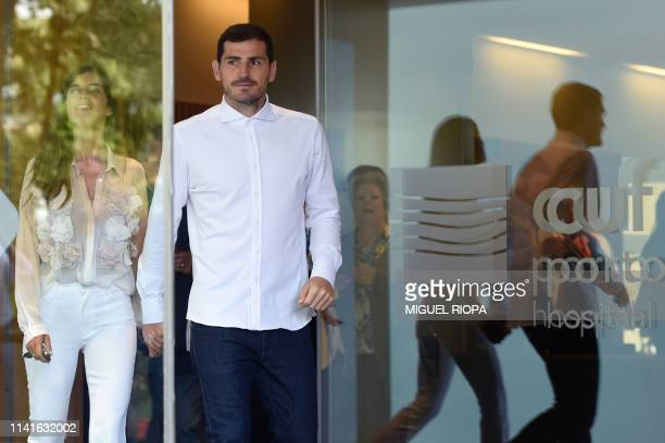 Porto's Spanish goalkeeper Iker Casillas leaves a hospital with his wife Sara Carbonero in Porto on May 06 2019 after recovering from a heart attack...