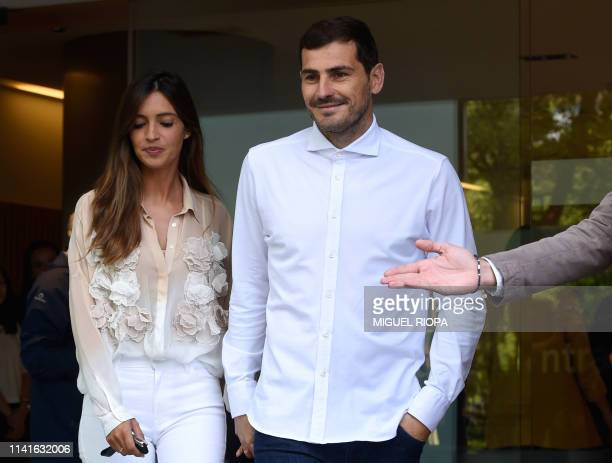 TOPSHOT Porto's Spanish goalkeeper Iker Casillas leaves a hospital with his wife Sara Carbonero in Porto on May 06 2019 after recovering from a heart...