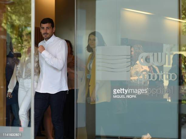 Porto's Spanish goalkeeper Iker Casillas leaves a hospital with his wife Sara Carbonero in Porto on May 6 2019 after recovering from a heart attack...