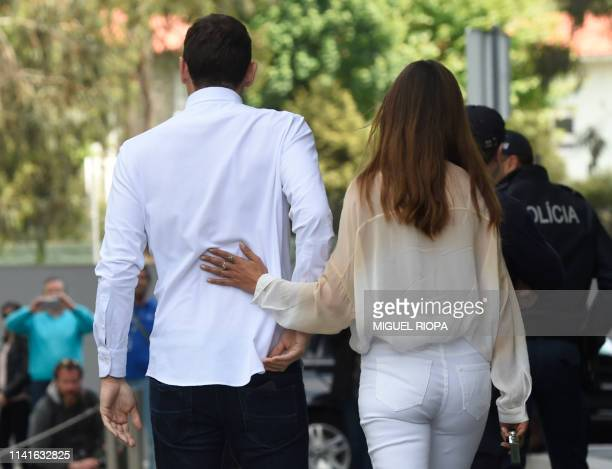 Porto's Spanish goalkeeper Iker Casillas leaves a hospital with his wife Sara Carbonero in Porto on May 6 after recovering from a heart attack The...