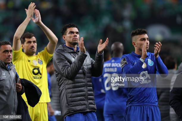 Porto's Spanish goalkeeper Iker Casillas Portuguese defender Pepe and Mexican forward Jesus Corona applaud the supporters after the Portuguese League...