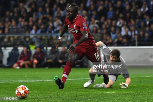 Porto's Spanish goalkeeper Iker Casillas prepares to stop a shot on goal by Liverpool's Senegalese striker Sadio Mane during the UEFA Champions...
