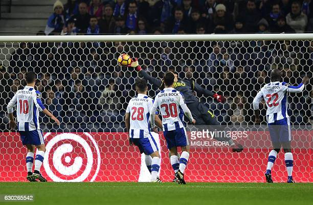 Porto's Spanish goalkeeper Iker Casillas saves a ball during the Portuguese league football match FC Porto vs GD Chaves at the Dragao stadium in...