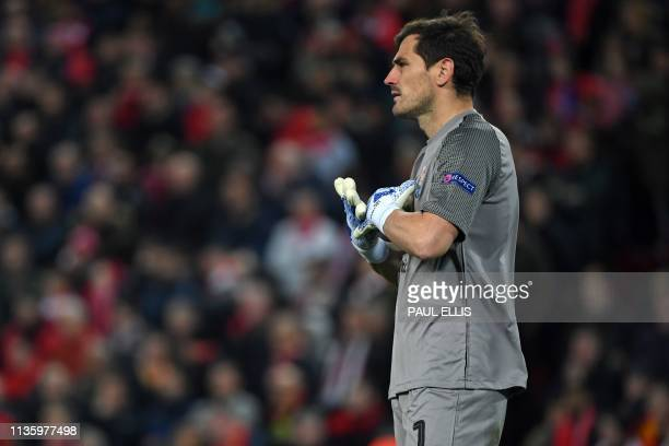 Porto's Spanish goalkeeper Iker Casillas watches play during the UEFA Champions League quarterfinal first leg football match between Liverpool and FC...