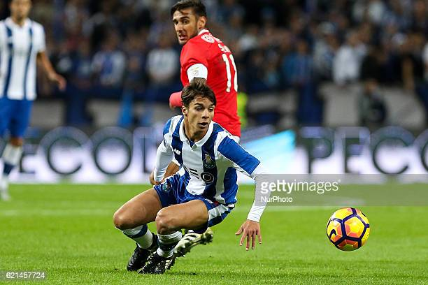 Porto's Spanish midfielder Oliver Torres in action with Benfica's Argentinian forward Toto Salvio during the Premier League 2016/17 match between FC...