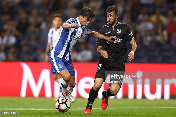 Porto's Spanish midfielder Oliver Torres in action with Vitoria SC's Portuguese defender Joao Aurelio during the Premier League 2016/17 match between...