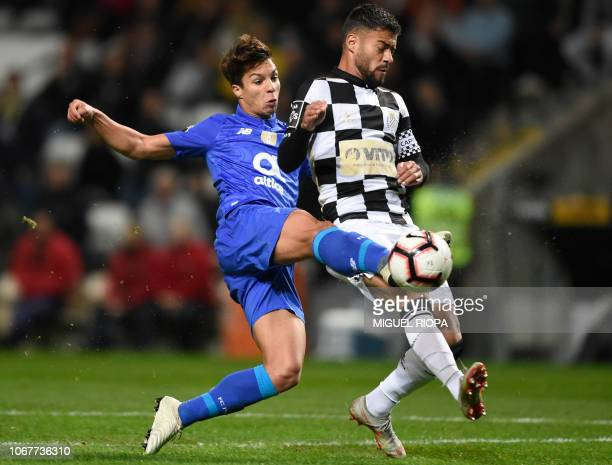 Porto's Spanish midfielder Oliver Torres kicks the ball next to Boavista's Portuguese midfielder Carraca during the Portuguese league football match...
