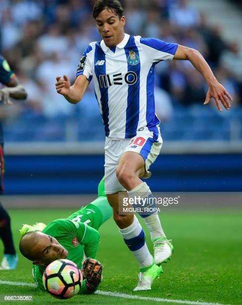 Porto's Spanish midfielder Oliver Torres tries to score a goal next to Belenenses' goalkeeper Cristiano Figueiredo during the Portuguese league...