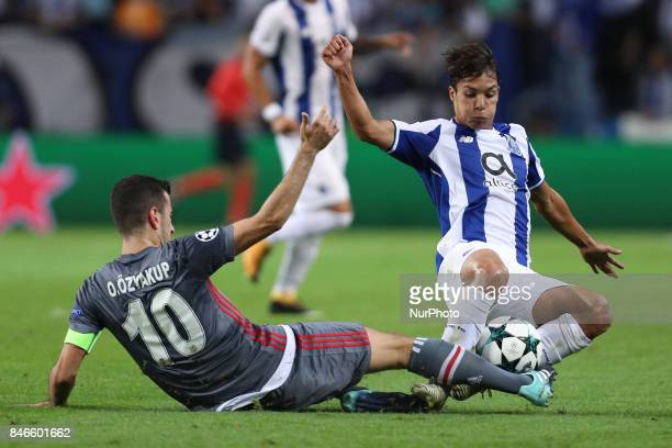 Porto's Spanish midfielder Oliver Torres vies with Besiktas' midfielder Oguzhan Ozyakup during the FC Porto v Besiktas UEFA Champions League Group G...