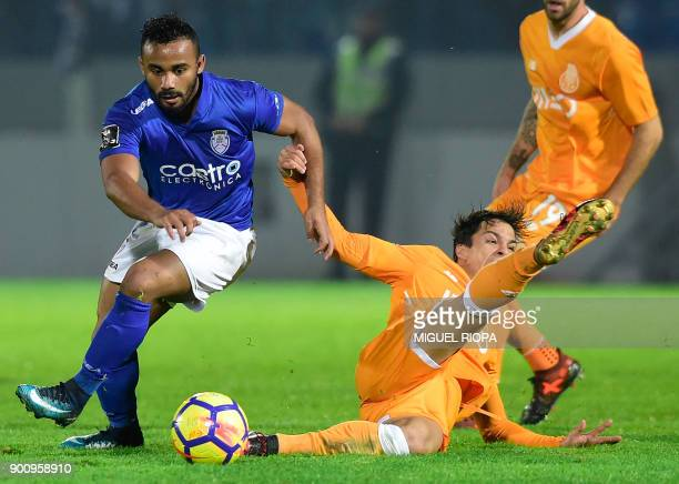 Porto's Spanish midfielder Oliver Torres vies with Feirense's Brazilian forward Edson Farias during the Portuguese league football match CD Feirense...