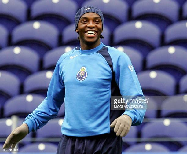 Porto's striker Benni McCarthy smiles as he warms up during a training session on the eve of their Champions league football match against Inter...