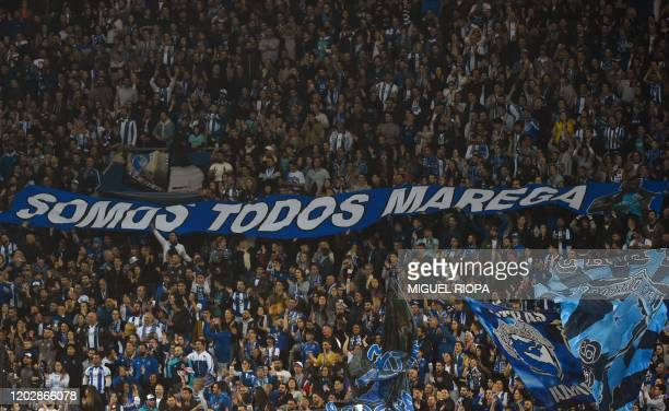 Porto's supporters hold a banner reading We are all Marega during the Portuguese league football match between FC Porto and Portimonense SC at the...